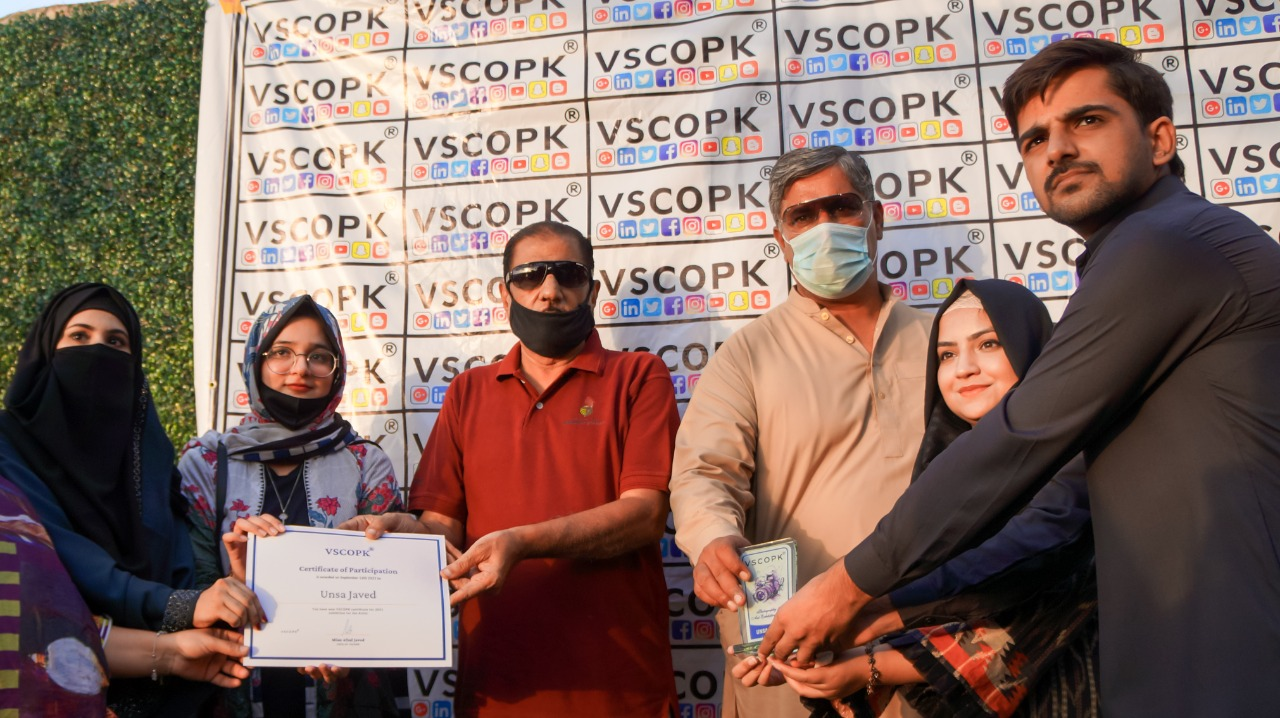 CEO Vscopk Mian Afzal Javed distributes shields to participants